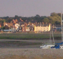 You can see Jolly Sailor Cottage by the sea shore